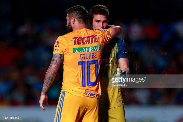 Andre-Pierre Gignac of Tigres embraces Sebastian Jurado Goalkeeper of Veracruz during the 14th round match between Veracruz and Tigres UANL as part...