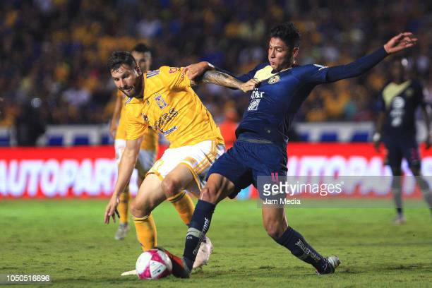 AndrePierre Gignac of Tigres fights for the bad with Edson Alvarez of America during the 12th round match between Tigres UANL and America as part of...