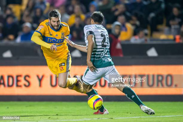 AndrePierre Gignac of Tigres fights for the ball with Carlos Izquierdoz of Santos during the 2nd round match between Tigres UANL and Santos Laguna as...