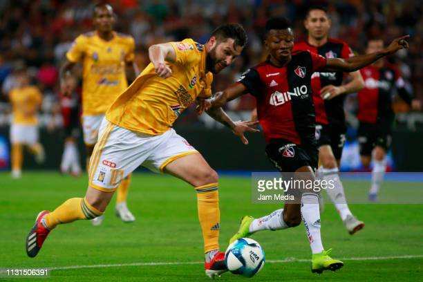 AndrePierre Gignac of Tigres fights for the ball with Clifford Aboagye of Atlas during the 8th round match between Atlas and Tigres UNAL as part of...
