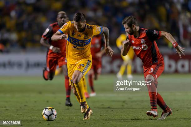 AndrePierre Gignac of Tigres fights for the ball with Drew Moor of Toronto during the quarterfinals second leg match between Tigres UANL and Toronto...