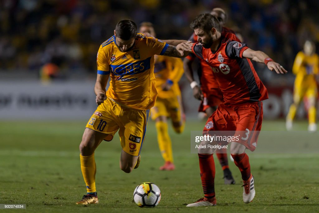 Andre-Pierre Gignac of Tigres fights for the ball with Drew Moor of Toronto during the quarterfinals second leg match between Tigres UANL and Toronto FC as part of the CONCACAF Champions League 2018 at Universitario Stadium on March 13, 2018 in Monterrey, Mexico.