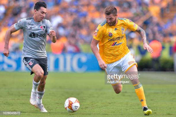 AndrePierre Gignac of Tigres fights for the ball with Ismael Govea of Atlas during the 6th round match between Tigres UANL and Veracruz as part of...