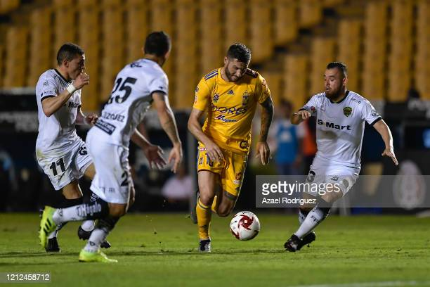 AndrePierre Gignac of Tigres fights for the ball with Israel Jiménez Mauro Fernández and Víctor Velázquez of Juárez during the 10th round match...
