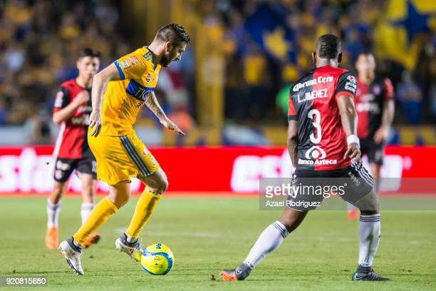 AndrePierre Gignac of Tigres fights for the ball with Leyton Jimenez of Atlas during the 8th round match between Tigres UANL and Atlas as part of the...