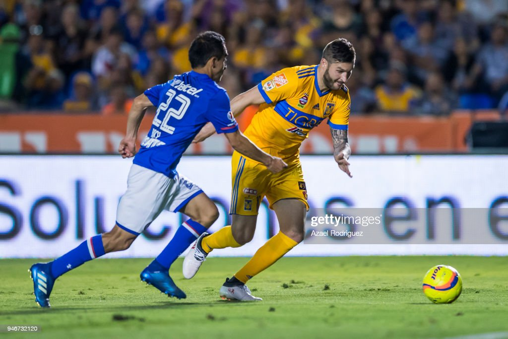Andre-Pierre Gignac of Tigres fights for the ball with Rafael Baca of Cruz Azul during the 15th round match between Tigres UANL and Cruz Azul as part of the Torneo Clausura 2018 Liga MX at Universitario Stadium on April 14, 2018 in Monterrey, Mexico.
