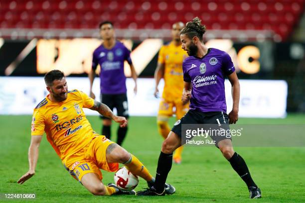 Andrepierre Gignac of Tigres fights for the ball with Saul Huerta of Mazatlan during the match between Mazatlan FC and Tigres UANL as part of...