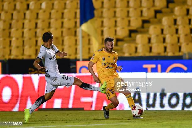 AndrePierre Gignac of Tigres fights for the ball with Víctor Velázquez of Juárez during the 10th round match between Tigres UANL and FC Juarez as...