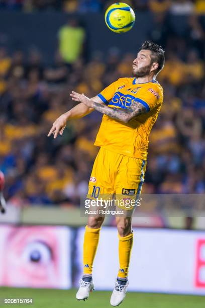 AndrePierre Gignac of Tigres heads the ball during the 8th round match between Tigres UANL and Atlas as part of the Torneo Clausura 2018 Liga MX at...
