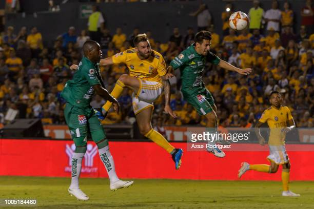 5e3c72b5640 AndrePierre Gignac of Tigres heads the ball with Andres Mosquera and  Fernando Navarro of Leon to