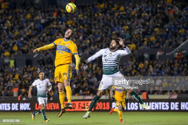 AndrePierre Gignac of Tigres heads the ball with Nestor Araujo of Santos during the 2nd round match between Tigres UANL and Santos Laguna as part of...