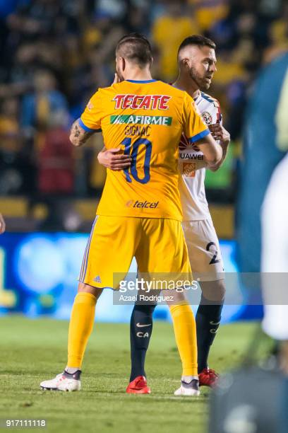 AndrePierre Gignac of Tigres hugs Jeremy Menez of America at the end of the 6th round match between Tigres UANL and America as part of the Torneo...