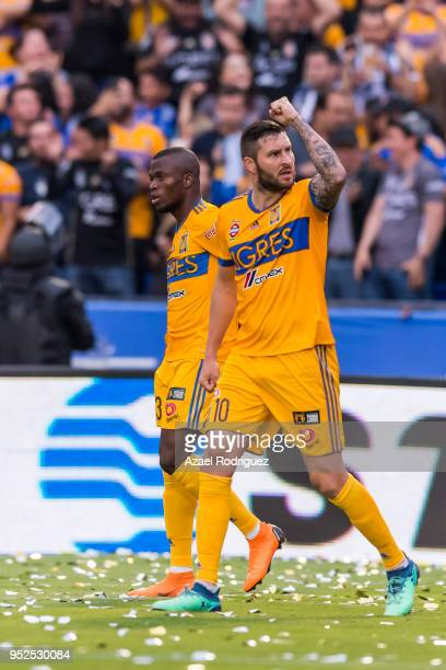 Andre-Pierre Gignac of Tigres reacts after teammate Enner Valencia score his team's first goal during the 17th round match between Tigres UANL and...