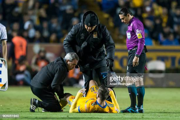AndrePierre Gignac of Tigres receives medical assistance during the 2nd round match between Tigres UANL and Santos Laguna as part of the Torneo...