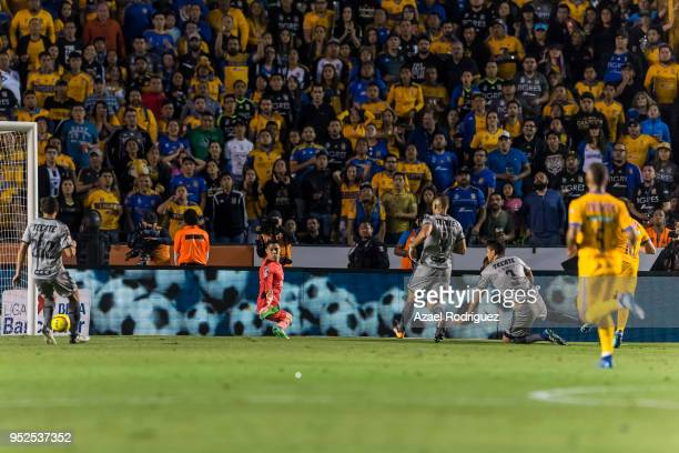 AndrePierre Gignac of Tigres scores his team's second goal during the 17th round match between Tigres UANL and Monterrey as part of the Torneo...