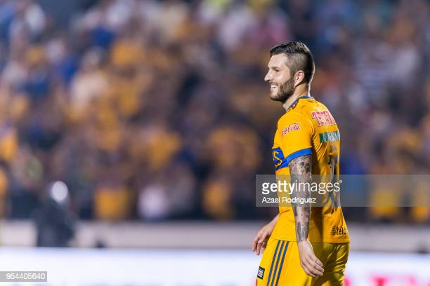 AndrePierre Gignac of Tigres smiles after scoring his team's second goal via penalty during the quarter finals first leg match between Tigres UANL...