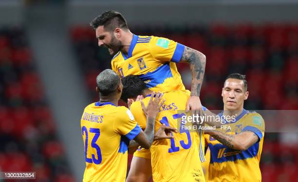 Andre-Pierre Gignac of Tigres UANL celebrates after scoring their sides first goal with team mates Luis Quinones and Diego Reyes during the FIFA Club...