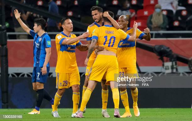 Andre-Pierre Gignac of Tigres UANL celebrates after scoring their sides second goal with team mates Jesus Duenas, Diego Reyes and Luis Quinones...