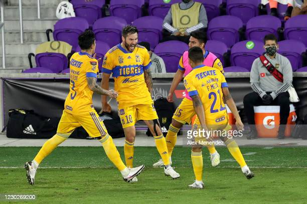 Andre-Pierre Gignac of Tigres UANL celebrates the game winning goal with Carlos Salcedo of Tigres UANL, Francisco Meza of Tigres UANL and Francisco...