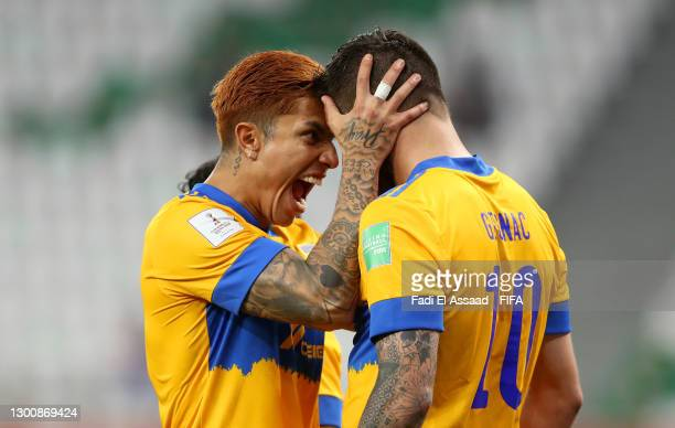 Andre-Pierre Gignac of Tigres UANL celebrates with teammate Carlos Salcedo after scoring their team's first goal during the FIFA Club World Cup Qatar...