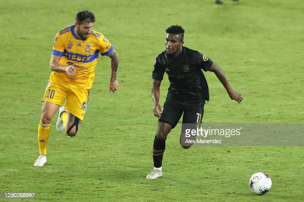 Andre-Pierre Gignac of Tigres UANL chases Jose Cifuentes of Los Angeles FC during the CONCACAF Champions League final game at Exploria Stadium on...