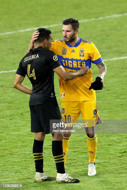 Andre-Pierre Gignac of Tigres UANL speaks with Eddie Segura of Los Angeles FC after Tigres UANLs championship win over Los Angeles FC during the...