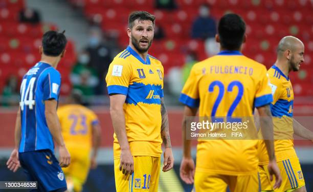 Andre-Pierre Gignac of Tigres UANL talks to teammate Raymundo Fulgencio during the FIFA Club World Cup Qatar 2020 Second Round match between Tigres...