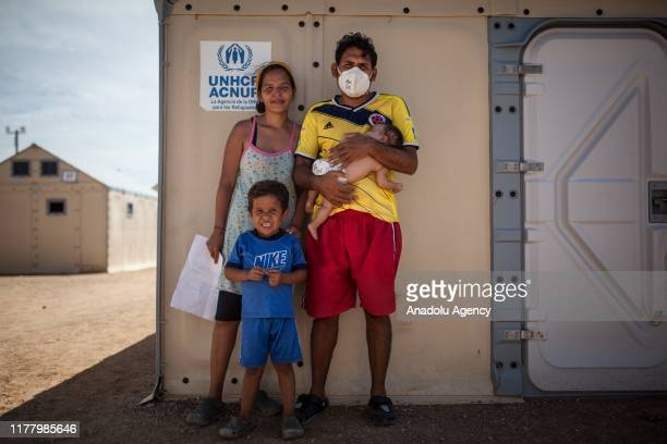 Andres, a Venezuelan poses for a photo with his family, after a long tuberculosis treatment, on their last day at the UNHCR camp in Maicao, La...
