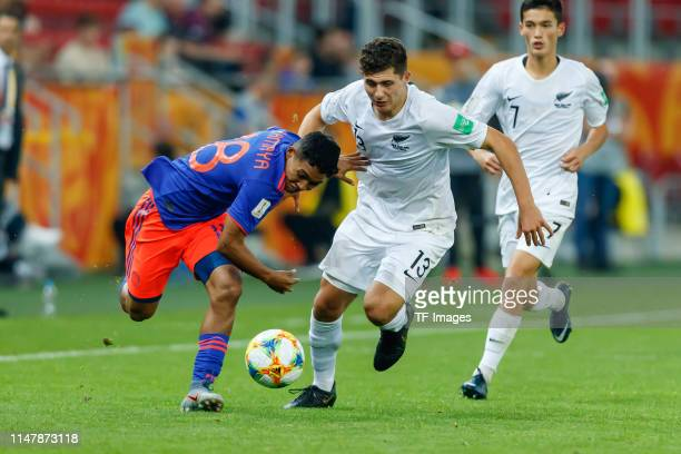 Andres Amaya of Colombia and Liberato Cacace of New Zealand battle for the ball during the 2019 FIFA U20 World Cup Round of 16 match between Colombia...