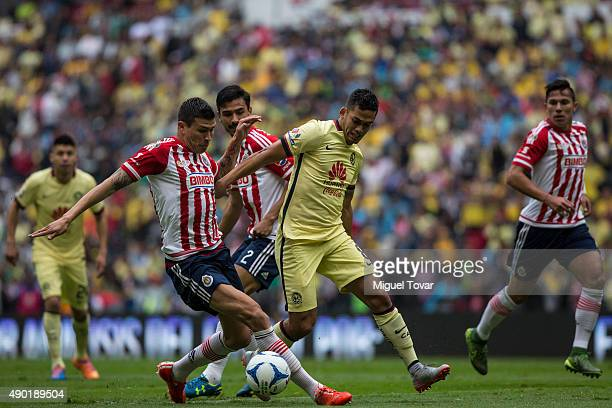 Andres Andrade of America fights for the ball with Jorge Enriquez of Chivas during a 10th round match between America and Chivas as part of the...