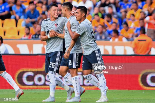 Andres Andrade of Atlas celebrates with teammates after the first goal of his team during the 6th round match between Tigres UANL and Veracruz as...