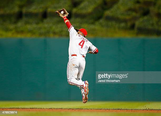 Andres Blanco of the Philadelphia Phillies catches a ball that was hit off of the foot of teammate Kevin Correia and caught for an out in the fifth...
