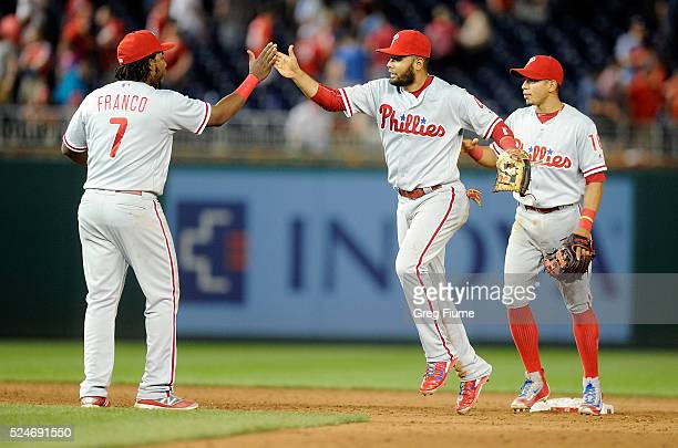 Andres Blanco of the Philadelphia Phillies celebrates with Maikel Franco after a 43 victory against the Washington Nationals at Nationals Park on...