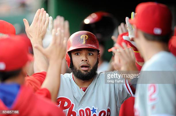 Andres Blanco of the Philadelphia Phillies celebrates with teammates after hitting a tworun home run in the first inning against the Washington...