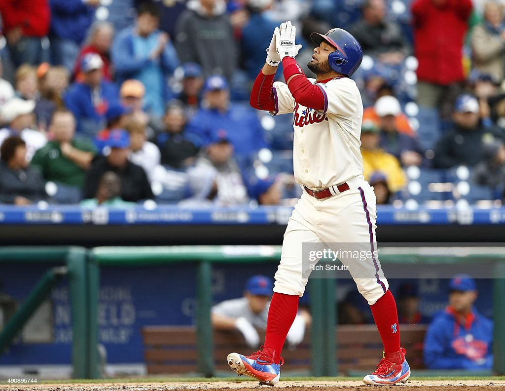 Andres Blanco #4 of the Philadelphia Phillies gestures as he steps on home plate after he hit a home run against the New York Mets during the eighth inning of a MLB game at Citizens Bank Park on October 1, 2015 in Philadelphia, Pennsylvania. The Phillies defeated the Mets 3-0.