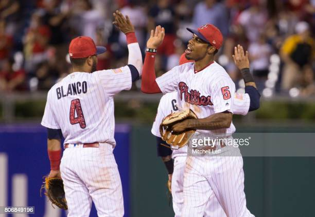 Andres Blanco of the Philadelphia Phillies high fives Nick Williams after the game against the Pittsburgh Pirates at Citizens Bank Park on July 3...