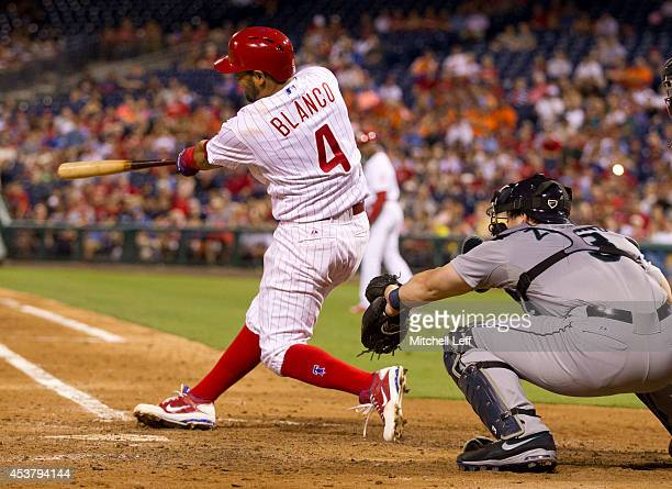 Andres Blanco of the Philadelphia Phillies hits a threerun home run in the bottom of the fifth inning against the Seattle Mariners on August 18 2014...