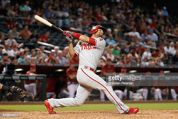 Andres Blanco of the Philadelphia Phillies hits a tworun single against the Arizona Diamondbacks during the eighth inning of the MLB game at Chase...