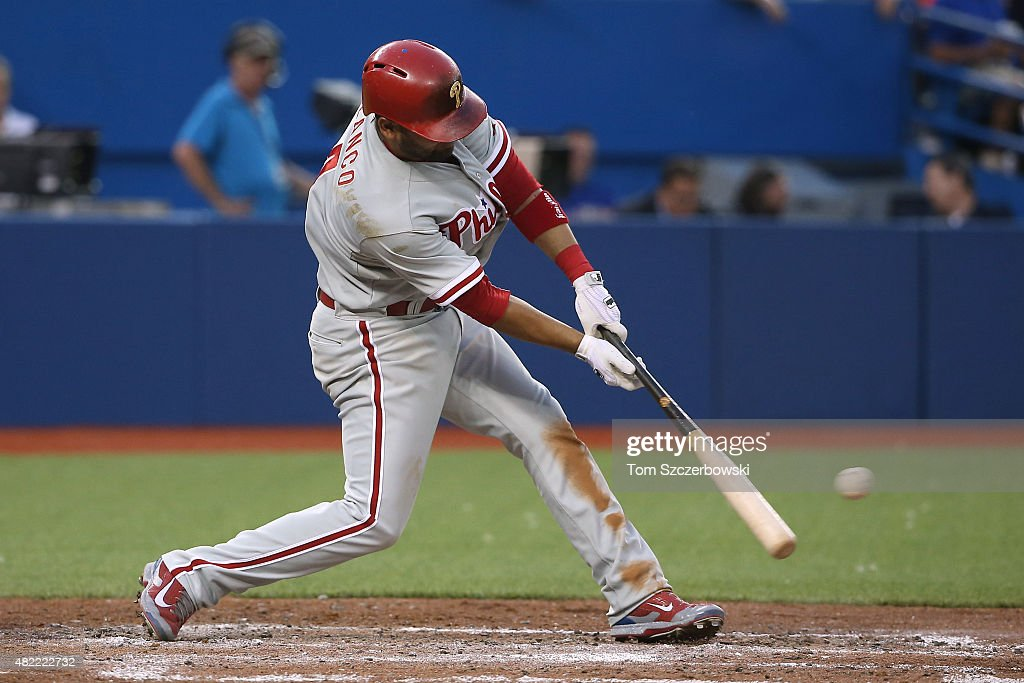 Andres Blanco #4 of the Philadelphia Phillies hits an RBI double in the fifth inning during MLB game action against the Toronto Blue Jays on July 28, 2015 at Rogers Centre in Toronto, Ontario, Canada.