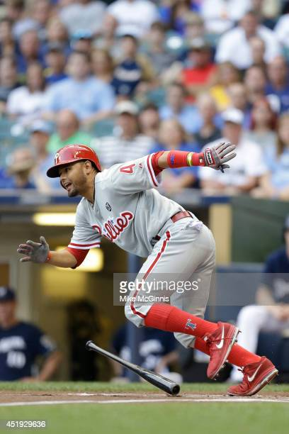 Andres Blanco of the Philadelphia Phillies runs to first base on contact during the game against the Milwaukee Brewers at Miller Park on July 07 2014...