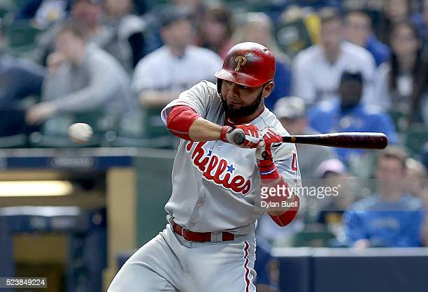 Andres Blanco of the Philadelphia Phillies swings at a pitch in the eighth inning against the Milwaukee Brewers at Miller Park on April 24 2016 in...