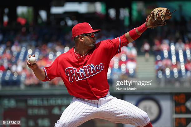 Andres Blanco of the Philadelphia Phillies throws to first base after fielding a ground ball in the fifth inning during a game against the Arizona...