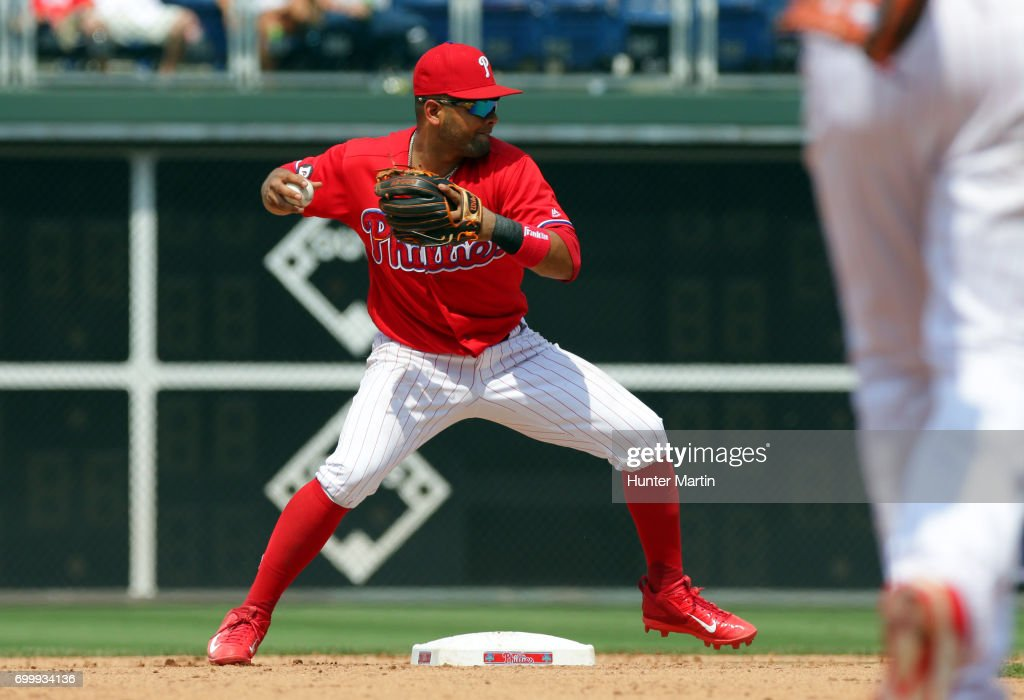 Andres Blanco #4 of the Philadelphia Phillies turns a double play in the eighth inning during a game against the St. Louis Cardinals at Citizens Bank Park on June 22, 2017 in Philadelphia, Pennsylvania. The Phillies won 5-1.