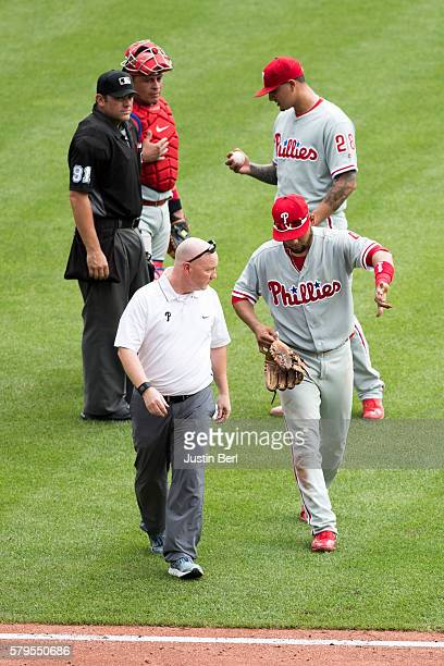 Andres Blanco of the Philadelphia Phillies walks off the field after taking a cleat to his hand in the fifth inning during the game against the...