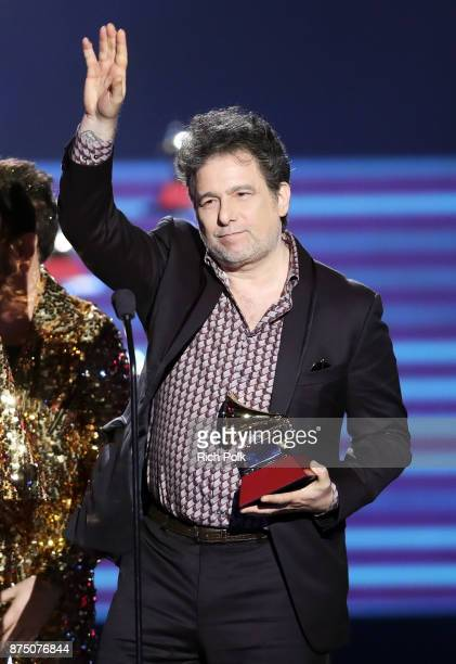 Andres Calamaro accepts Best Rock Song for 'La Noche' onstage at the Premiere Ceremony during the 18th Annual Latin Grammy Awards at the Mandalay Bay...