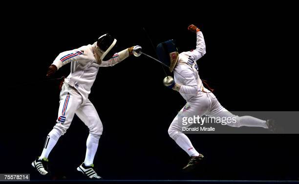 Andres Carrillo of Cuba in action against Ruben Lamardo of Venezula during the Gold Medal Match of the Men's Team Epee part of the XV Pan American...