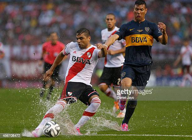Andres Chavez of Boca Juniors and Gabriel Mercado of River Plate struggle for the ball during a match between River Plate and Boca Juniors as part of...