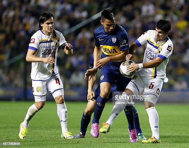 Andres Chavez of Boca Juniors fights for the ball with Nestor Gonzalez of Deportivo Capiata during a match between Boca Juniors and Deportivo Capiata...