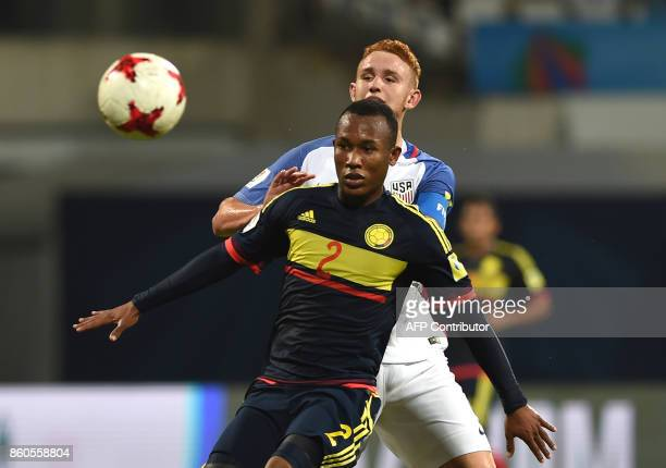 Andres Cifuentes of Colombia and Josh Sargent of USA vie for a ball during the group stage football match between USA and Colombia in the FIFA U17...