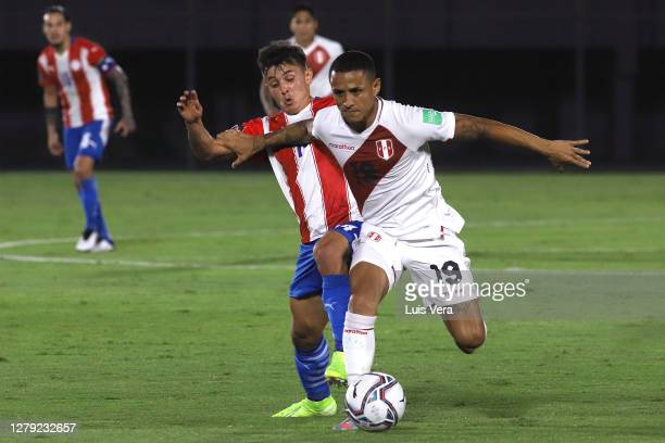 Andres Cubas of Paraguay fights for the ball with Yoshimar Yotun of Peru during a match between Paraguay and Peru as part of South American...